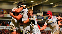 Rob Herring of Ulster celebrates with team-mates after scoring his side's first try