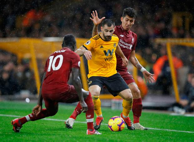 Wolverhampton Wanderers' Jonny Castro is boxed in by Liverpool's Roberto Firmino and Sadio Mane. Photo: Carl Recine/Reuters