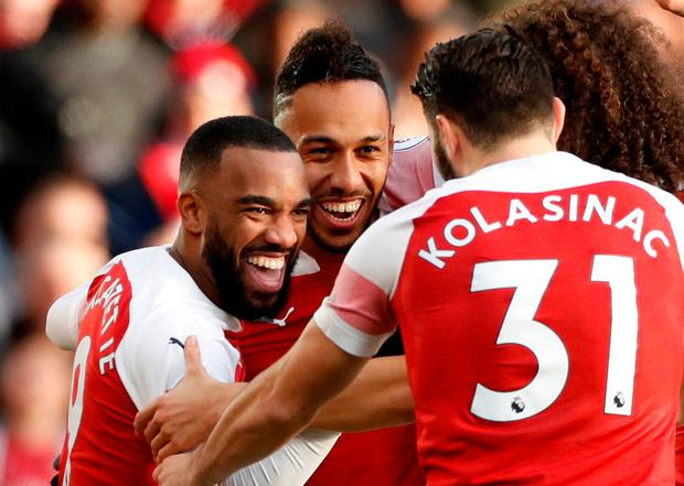 Arsenal's Pierre-Emerick Aubameyang celebrates scoring their second goal with Alexandre Lacazette and team mates. Action Images via Reuters/John Sibley