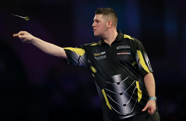 Daryl Gurney throws during his third round match against Jamie Lewis during Day 10 of the 2019 William Hill World Darts Championship. (Photo by Paul Harding/Getty Images)