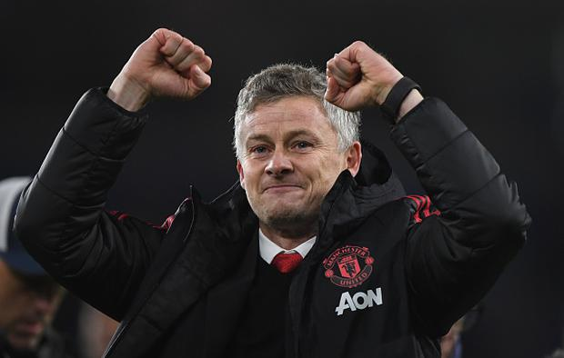 Ole Gunnar Solskjaer, Interim Manager of Manchester United celebrates with the fans after the Premier League match between Cardiff City and Manchester United (Photo by Stu Forster/Getty Images)
