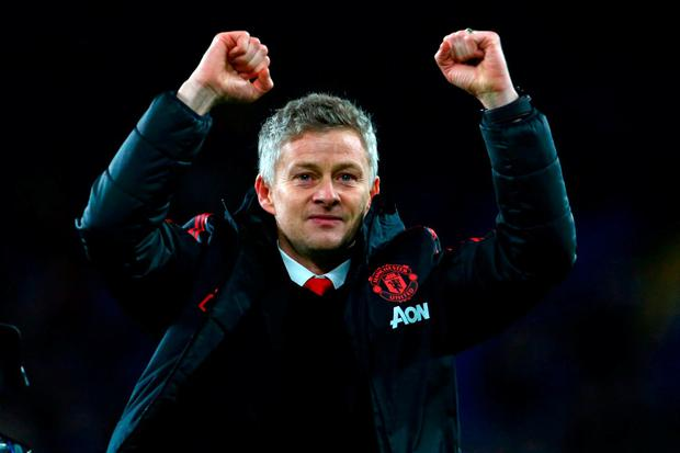 Ole Gunnar Solskjaer celebrates after Manchester United's victory over Cardiff City last night. Photo: Stu Forster