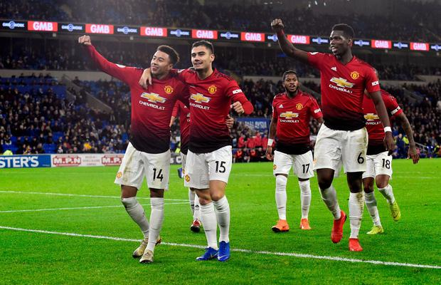 Manchester United's Jesse Lingard celebrates scoring their fifth goal with team mates. Photo: Rebecca Naden/Reuters