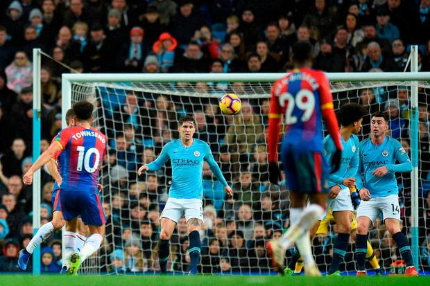 Crystal Palace's Andros Townsend strikes the ball to score a wonder volley in his side's shock victory over Manchester City at the Etihad Stadium yesterday. Photo: Oli Scarff