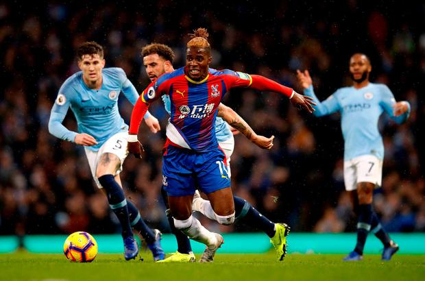 Crystal Palace's Wilfried Zaha is fouled by Manchester City's Kyle Walker. Photo: Martin Rickett/PA Wire