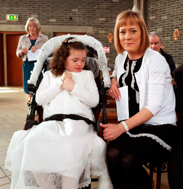 Constrained: Robyn Kilgallon and her mother Cabrini at her First Communion this year
