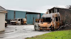 Burnt-out vehicles at the property in Strokestown, Co Roscommon. Photo: Frank McGrath