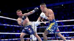 MANCHESTER, ENGLAND - DECEMBER 22: Josh Warrington punches Carl Frampton during the IBF World Featherweight Championship title fight between Josh Warrington and Carl Frampton at Manchester Arena on December 22, 2018 in Manchester, England. (Photo by Alex Livesey/Getty Images)