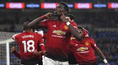 CARDIFF, WALES - DECEMBER 22: Manchester United player Paul Pogba celebrates after the 5th goal during the Premier League match at Cardiff City Stadium on December 22, 2018 in Cardiff, United Kingdom. (Photo by Stu Forster/Getty Images)