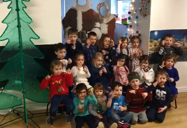 Children from An Mac Leinn Beag in Kiltimagh, Co Mayo signing 'We Wish You A Merry Christmas'