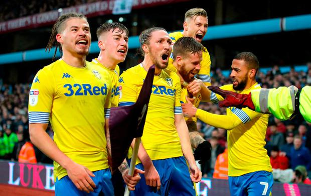 Leeds United's Pontus Jansson (second right) celebrates scoring his side's second goal of the game with team mates during the Sky Bet Championship match at Villa Park