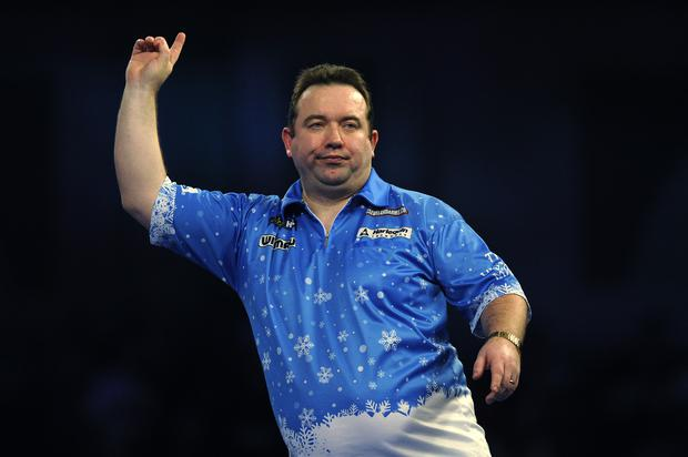 Brendan Dolan celebrates during his match against Mervyn King at the 2019 William Hill World Darts Championship at Alexandra Palace (Photo by Alex Burstow/Getty Images)