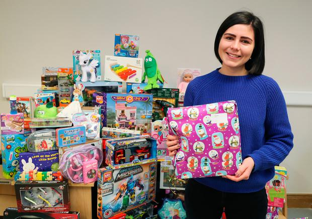 Aideen Conway from the Jesuit Refugee Service with some of the donations to their Christmas Toy Appeal for children in Direct Provision Photo credit: Brian Lawless/PA Wire