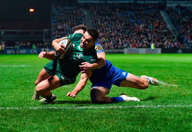 Cian Kelleher dives over to score Connacht's first try despite the efforts of Hugo Keenan. Photo by Matt Browne/Sportsfile