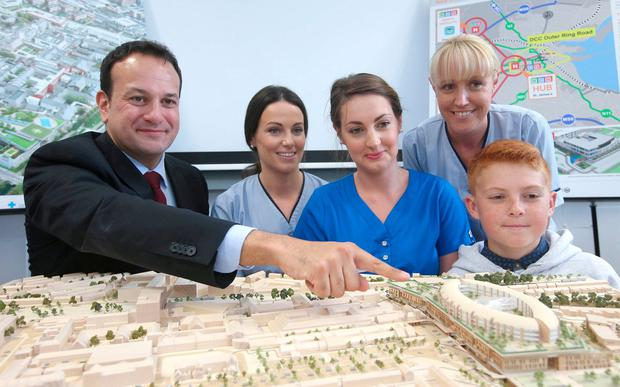 Model vision: Leo Varadkar with Aoife Dillon of Temple Street Children's Hospital, Caoimhe Wade of Crumlin Children's Hospital, Amanda McCormack of Tallaght Hospital and Darragh Barry from Portlaoise view a model of the new hospital. Photo: Damien Eagers