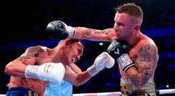 Josh Warrington (left) and Carl Frampton exchange blows during their title fight in Manchester. Photo by Alex Livesey/Getty Images