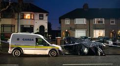 Tragedy: Gardaí at the scene of the horrific accident that saw a young woman lose her life. Photo: Arthur Carron