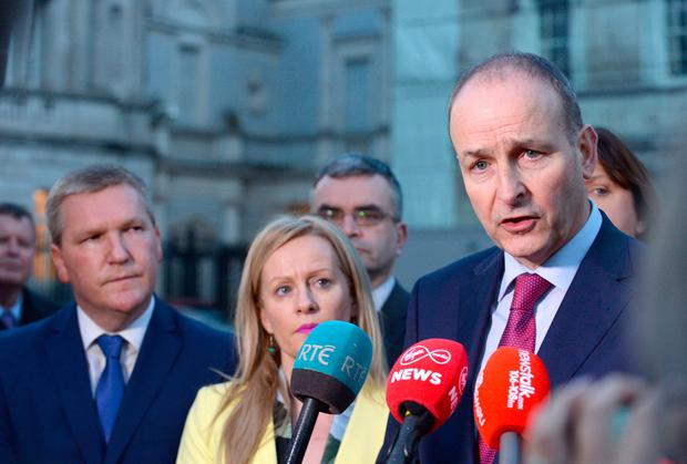 Talking point: Fianna Fáil leader Micheál Martin speaks to the media outside Leinster House. Photo: Caroline Quinn