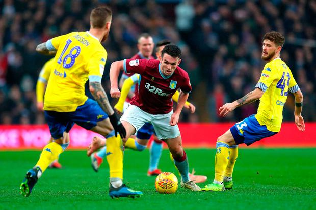 John McGinn of Aston Villa is surrounded during the match. Photo by Catherine Ivill/Getty Images