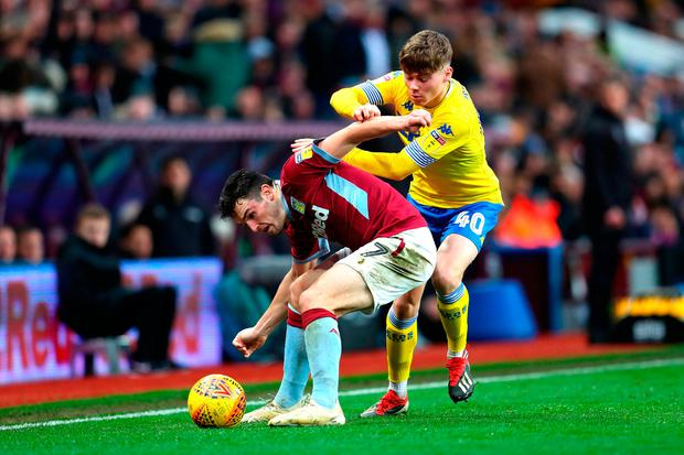 John McGinn of Aston Villa and Leif Davis of Leeds United battle for the ball. Photo by Catherine Ivill/Getty Images
