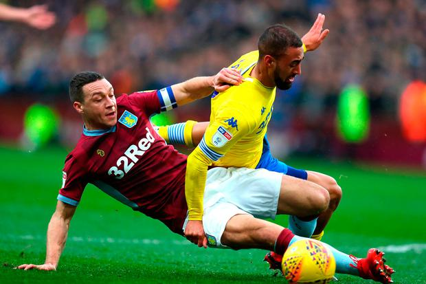 Kemar Roofe of Leeds United is tackled by James Chester of Aston Villa. Photo by Catherine Ivill/Getty Images