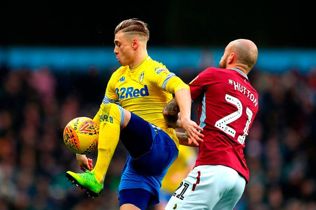 Ezgjan Alioski of Leeds United controlls the ball under pressure from Alan Hutton of Aston Villa. Photo by Catherine Ivill/Getty Images