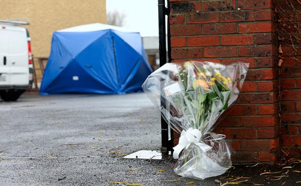 Flowers laid at the scene of the murder