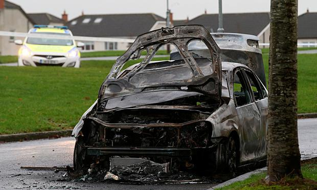 The burnt-out Volkswagen Jetta found in the wake of Saturday's shooting