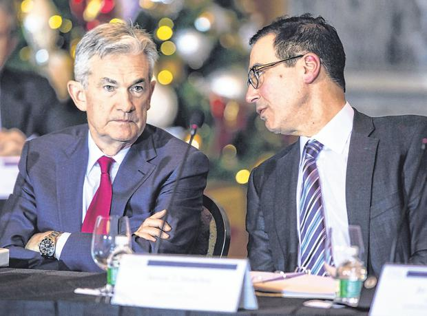 Money men: US Treasury Secretary Steven Mnuchin (right) with chairman of the Federal Reserve Jerome Powell, who is said to have angered Donald Trump. Photo: Al Drago/Bloomberg