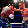 CLOSE QUARTERS: Carl Frampton (right) in action against Josh Warrington during their IBF World Featherweight title bout at the Manchester Arena on Saturday. Photo by David Fitzgerald/Sportsfile
