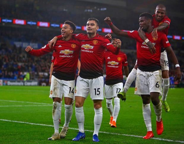 Jesse Lingard (left) celebrates with some of his team-mates after scoring Manchester United's fifth goal in Cardiff. Photo: Geoff Caddick/AFP/Getty Images