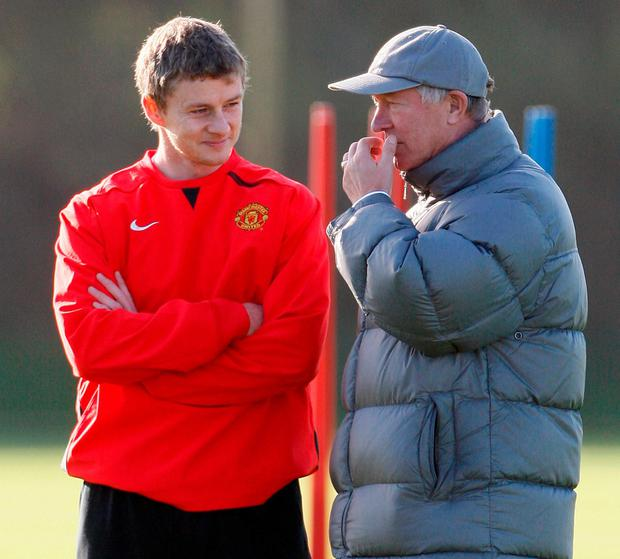 Ole Gunnar Solskjaer here listening to words of advice from former Manchester United boss Alex Ferguson on the training ground in 2007 – he's also likely to take his counsel in the coming months. Photo: Phil Noble/Reuters