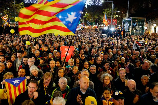 Protesters hold Catalan flags during a rally in Barcelona. Photo: AP Photo/Emilio Morenatti