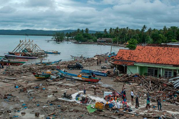 People inspect the damage at a tsunami-ravaged village in Sumur, Indonesia, Monday, Dec. 24, 2018. (AP Photo/Fauzy Chaniago)