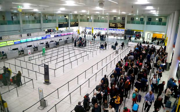 Passengers queue for flights at Gatwick Airport as the airport and airlines work to clear the backlog of flights delayed by the drone incident earlier this week. PRESS ASSOCIATION Photo.