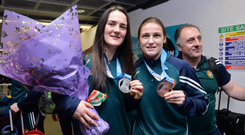 Kellie Harrington, left, says that should would like to eventually fight Katie Taylor (right), but that the odds are against it. Photo by Cody Glenn/Sportsfile