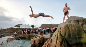 Hardy souls jump into the sea during the annual Christmas swim at Dublin's 40 Foot.Picture Credit:Frank McGrath 25/12/18