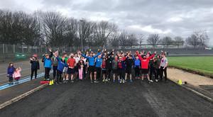 Participants in the GOAL Mile at Eamonn Ceannt Park on Sundrive Road pose for a picture after completing their run.