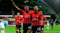 Michael Obafemi celebrates scoring for Southampton with team-mate Nathan Redmond. Photo: PA