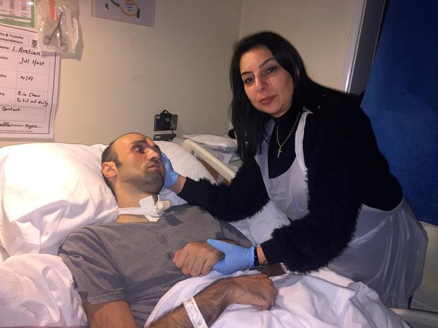 Wife Anzhela caring for him