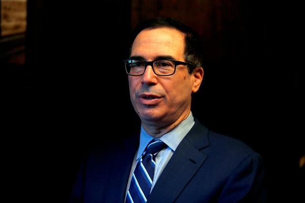 Firefighting: US Treasury Secretary Steven Mnuchin tried to calm markets with phone calls to big banks. Photo: REUTERS