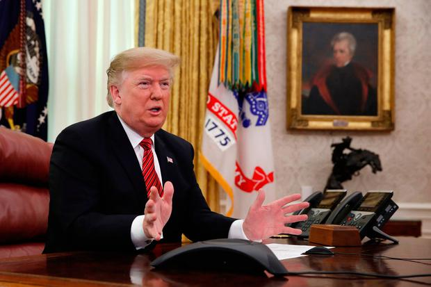 US President Donald Trump greets members of the five branches of the military by video conference on Christmas Day, in the Oval Office of the White House. AP Photo/Jacquelyn Martin