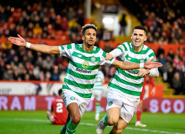 Celtic's Scott Sinclair (left) celebrates scoring his side's second goal of the game with Tom Rogic during the Scottish Premiership match at Pittodrie Stadium, Aberdeen. Wednesday December 26, 2018. Ian Rutherford/PA Wire.