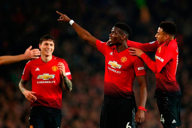 MANCHESTER, ENGLAND - DECEMBER 26: Paul Pogba of Manchester United celebrates with team mates Victor Lindelof, Jesse Lingard and Juan Mata of Manchester United after scoring their team's third goal during the Premier League match between Manchester United and Huddersfield Town at Old Trafford on December 26, 2018 in Manchester, United Kingdom. (Photo by Clive Brunskill/Getty Images)