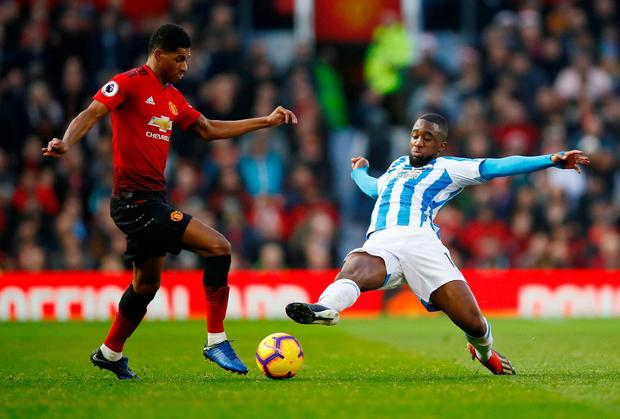 Manchester United's Marcus Rashford in action with Huddersfield Town's Isaac Mbenza. Photo: Jason Cairnduff/Action Images via Reuters