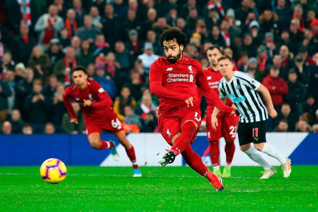 Mohamed Salah scores his team's second goal. Photo: Getty