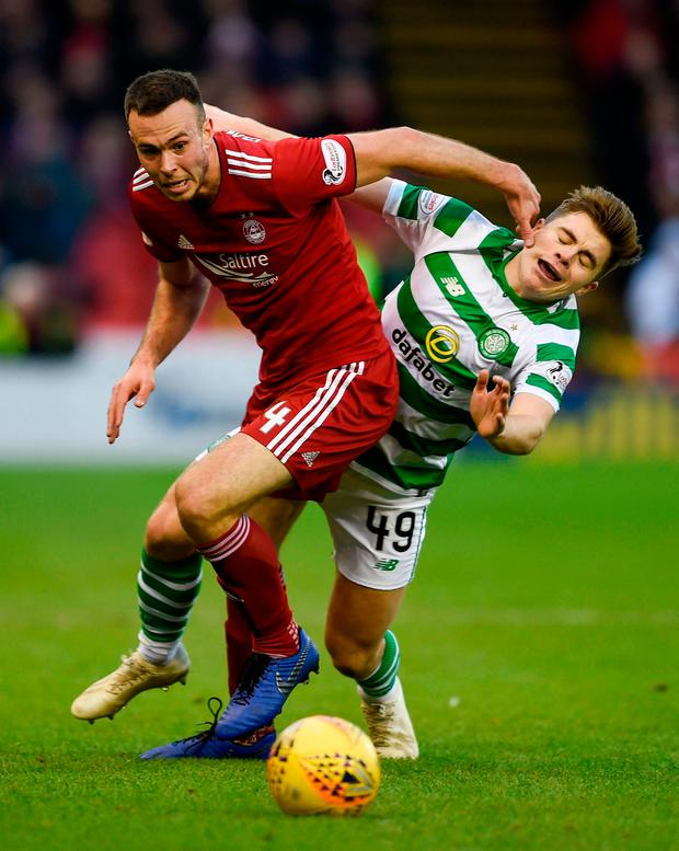 Aberdeen's Andrew Considine (left) and Celtic's James Forrest battle for the ball. Photo: PA