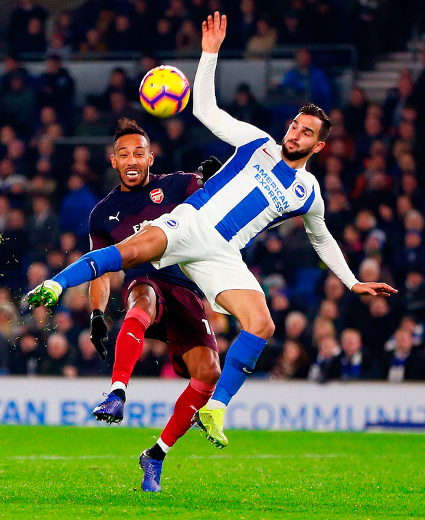 Pierre-Emerick Aubameyang of Arsenal challenges for the ball with Martin Montoya of Brighton & Hove Albion. Photo: Getty