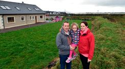Fearful: Patrick, Noreen and Sophie O'Sullivan pictured at their home in Lower Cromane, Co Kerry Photo: Don MacMonagle
