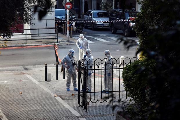 Forensics officers stand outside the Saint Dionysios church yard, following the detonation of an explosive device in Athens, Greece, December 27, 2018. REUTERS/Michalis Karagiannis